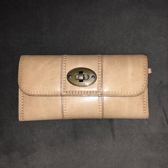 3ba9a8706b Fossil Handbags - Fossil Lock   Key Wallet in Tan